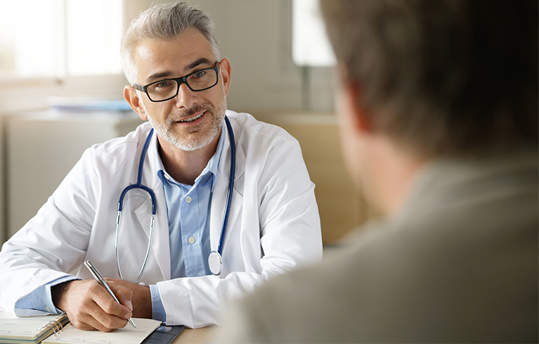 Male physician talking with patient